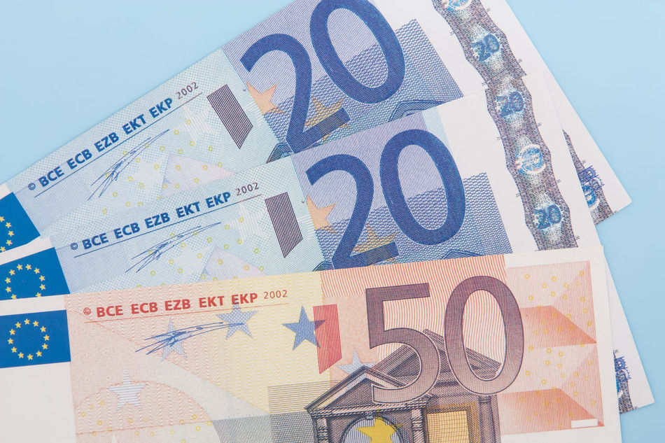 Various euro notes on light blue background Accounting Banking Credit Currency Debit Debt Euro Crisis Euro Notes Euro Zone Financial Financial Planning Financial Service Income Money Money Money Money Mortgage Pocket Money Spending Money