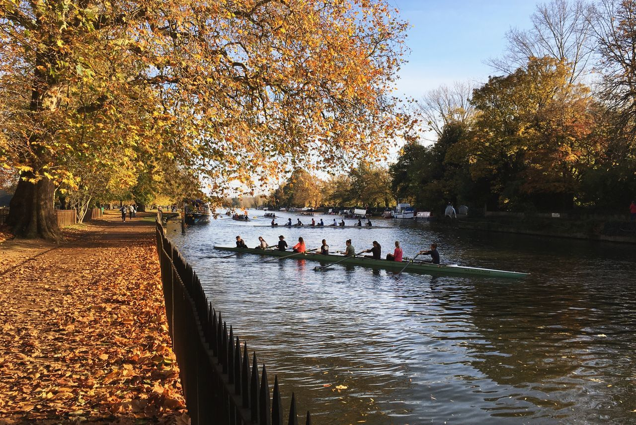 People On Boat At River By Trees During Autumn