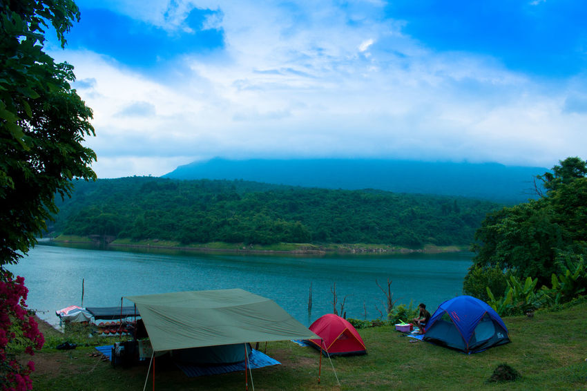 Camping Nature Tranquility Trees Vacations Beauty In Nature Cloud - Sky Landscape Outdoors River Scenics Sky Tents Tranquil Scene Water