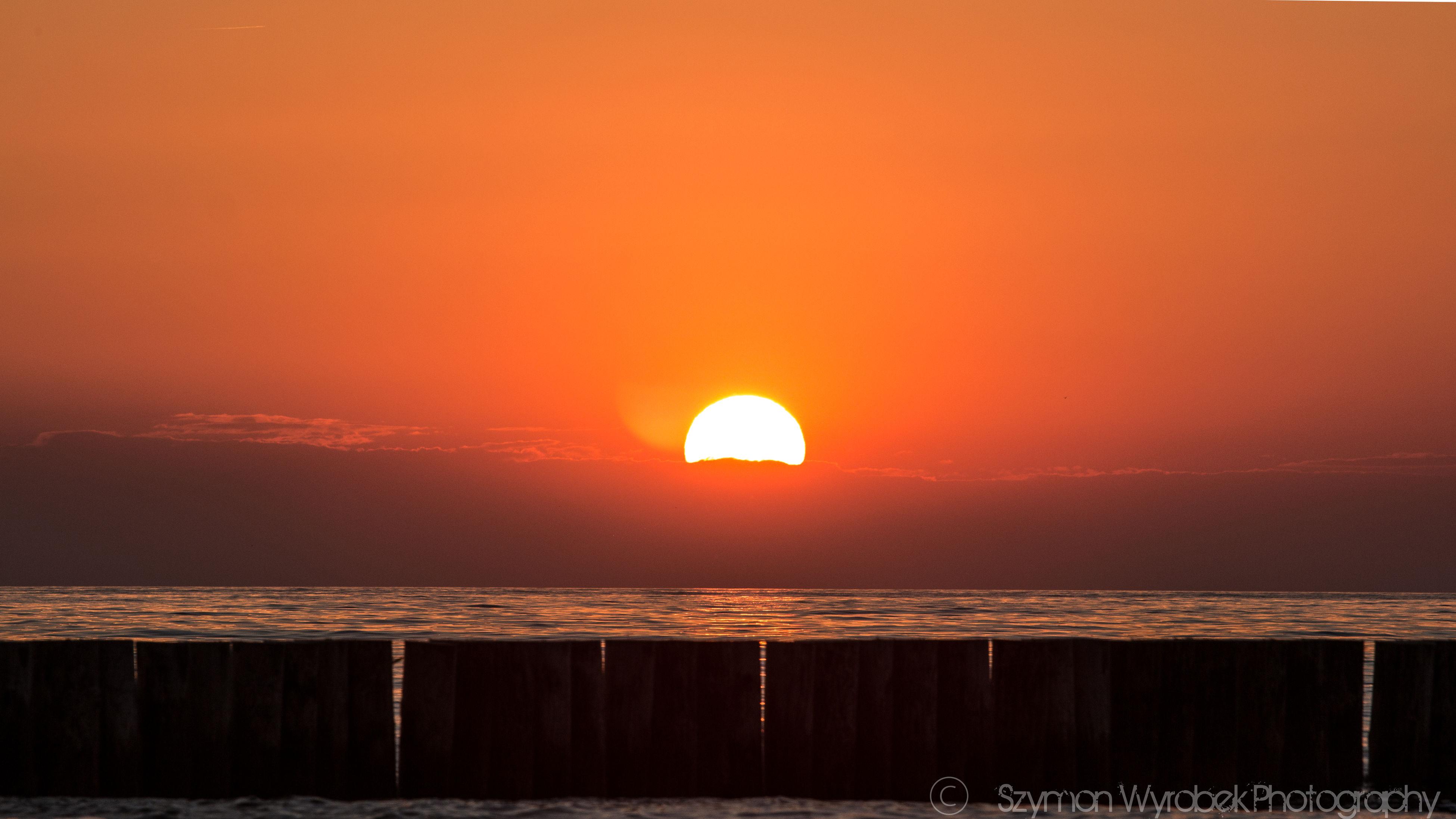 sunset, orange color, horizon over water, sea, scenics, sun, beauty in nature, tranquil scene, water, tranquility, idyllic, sky, nature, remote, outdoors, majestic, no people, non-urban scene, dramatic sky, cloud - sky, seascape, calm, cloud