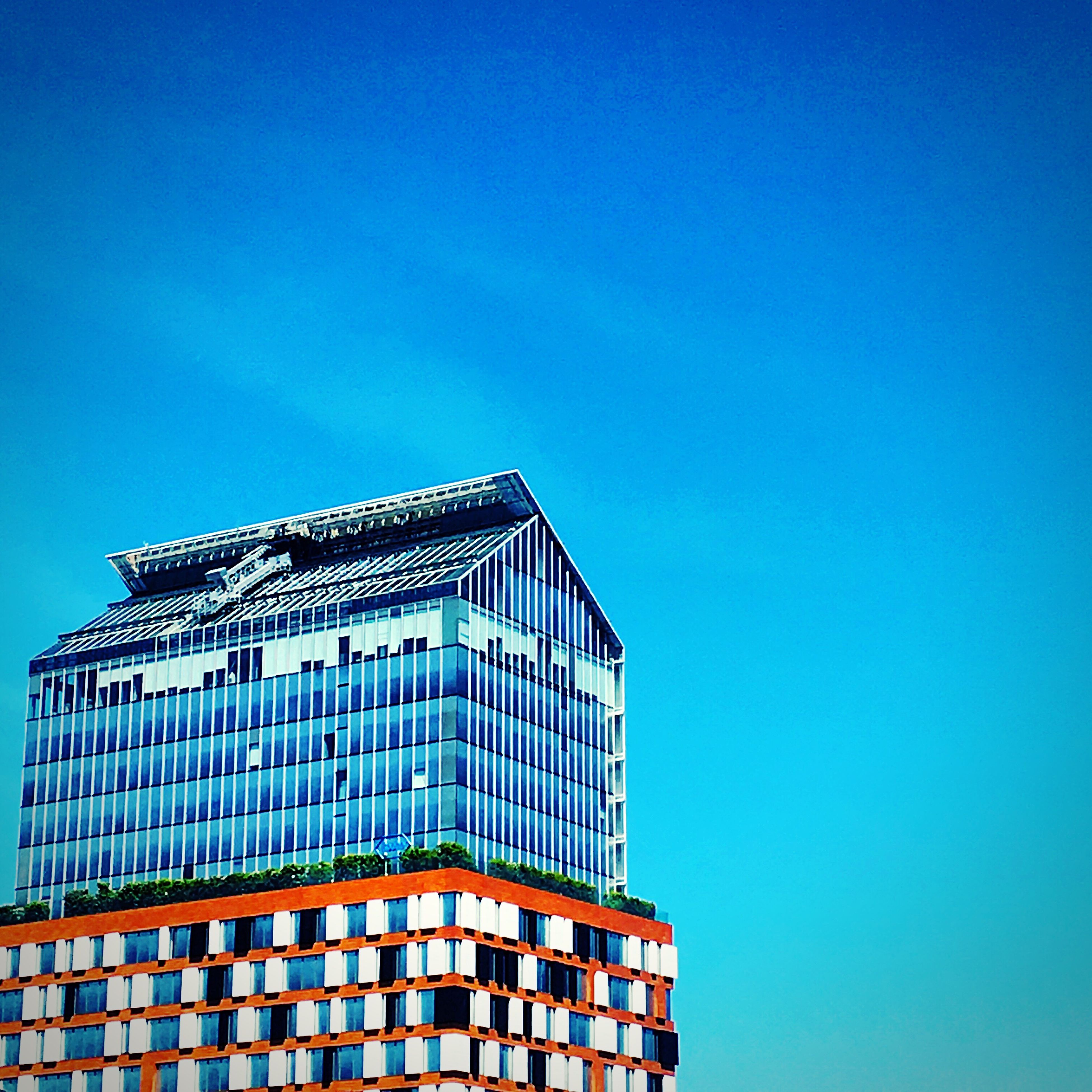 architecture, building exterior, built structure, clear sky, blue, low angle view, copy space, building, city, modern, window, office building, tall - high, outdoors, day, residential structure, no people, tower, high section, residential building