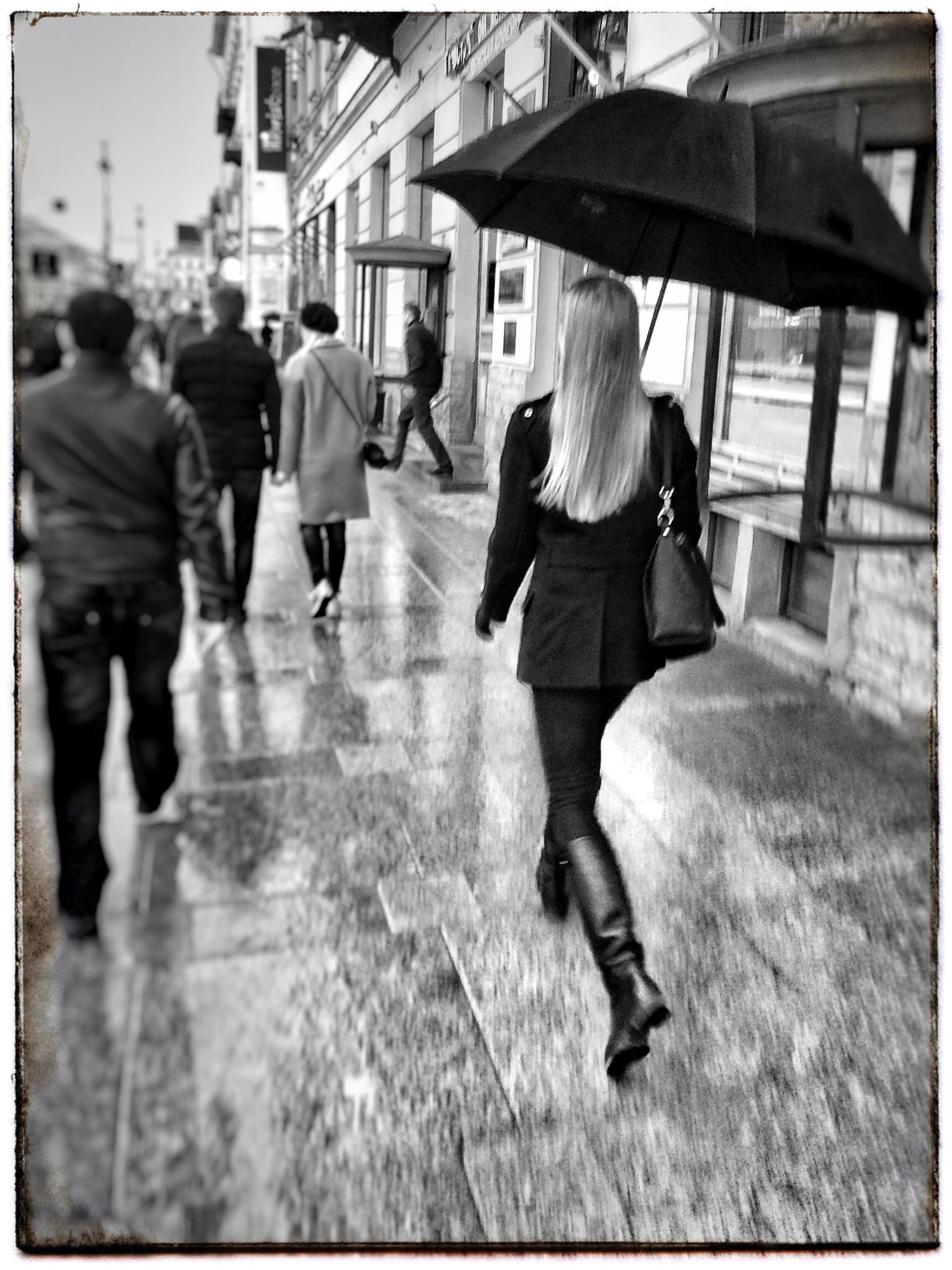 walking, lifestyles, transfer print, full length, street, person, men, rear view, leisure activity, auto post production filter, umbrella, city life, city, building exterior, casual clothing, built structure, architecture, rain, wet