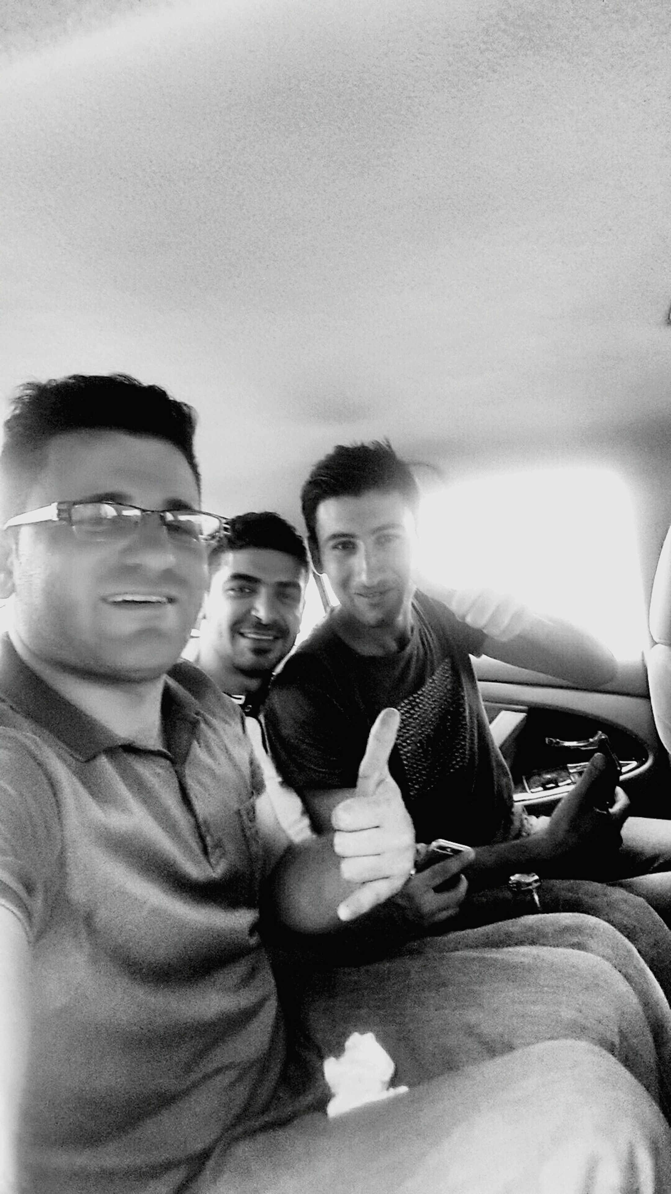 lifestyles, person, togetherness, leisure activity, bonding, portrait, looking at camera, young adult, smiling, young men, sitting, casual clothing, front view, transportation, happiness, love, mode of transport
