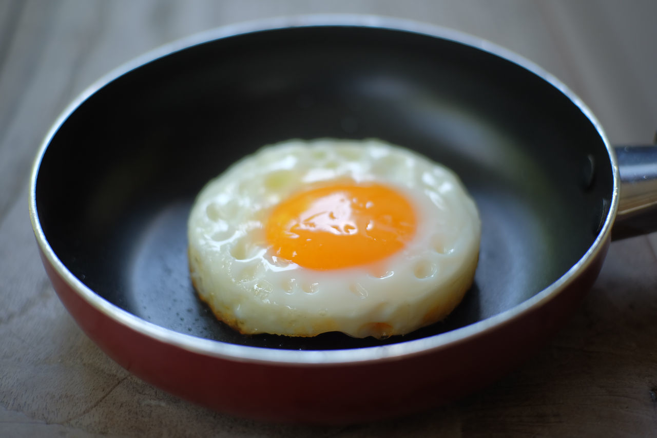 fried egg with pan on wood table Close Up Close-up Cooked Cooking Egg Egg Fried Floor Food Fried Fried Egg Macro Material Near Pan Side Dish Table Thai Food Vintage Wood Wood Floor Wood Table