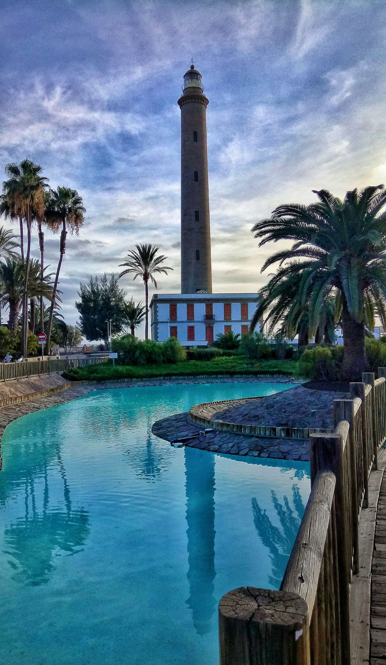 Reflection. Architecture Building Exterior Built Structure Clock Clock Tower Cloud - Sky Day Nature No People Outdoors Palm Tree Sky Swimming Pool Tower Travel Travel Destinations Tree Water