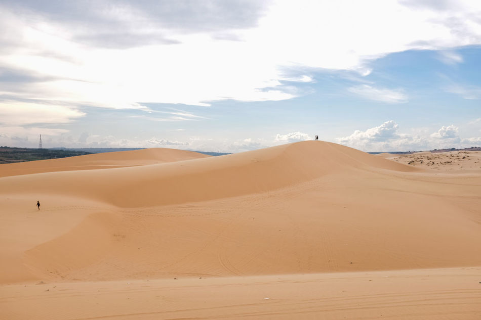 White Sand Dunes, Mui Ne, located in the south of Vietnam. It's about 5-hour away from Ho Chi Minh City. Arid Climate Beauty In Nature Cloud - Sky Day Desert Landscape Muine Muine, Vietnam  Nature No People Outdoors Physical Geography Sand Sand Dune Scenics Sky Sunlight Tranquil Scene Tranquility White Sand Dunes Break The Mold TCPM