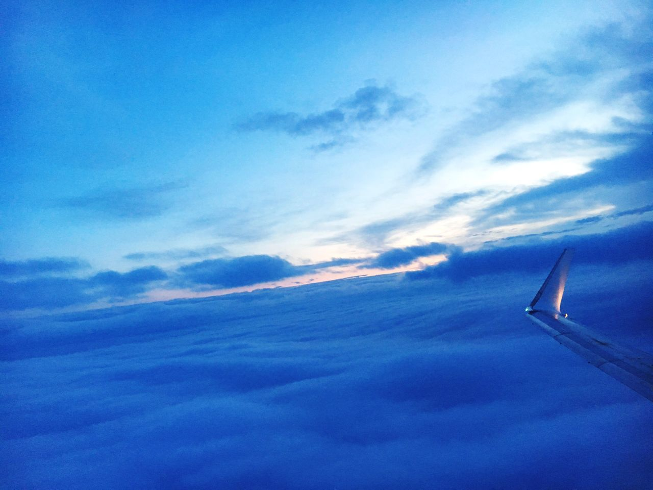 sky, airplane, cloud - sky, transportation, journey, beauty in nature, scenics, blue, nature, aerial view, cloudscape, airplane wing, travel, no people, flying, mode of transport, tranquil scene, tranquility, outdoors, aircraft wing, air vehicle, sky only, mid-air, sunset, day