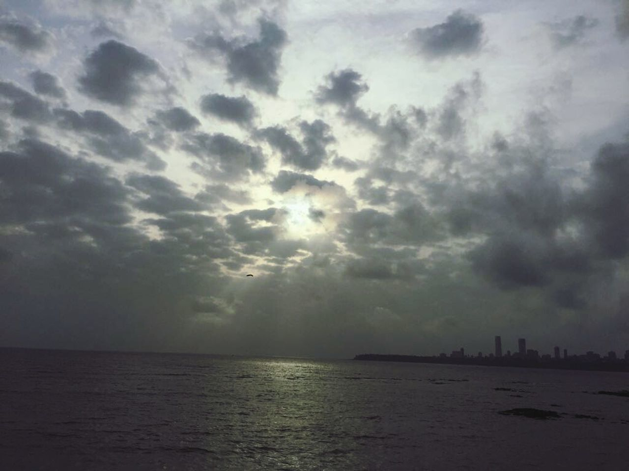 sea, cloud - sky, sky, architecture, built structure, building exterior, water, tranquility, waterfront, no people, nature, outdoors, scenics, sunset, beauty in nature, travel destinations, horizon over water, skyscraper, storm cloud, city, day, cityscape
