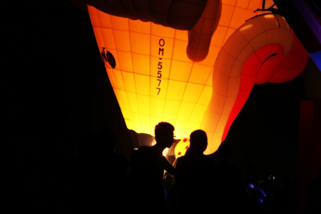 lifestyles, leisure activity, illuminated, night, orange color, fun, enjoyment, dark, multi colored