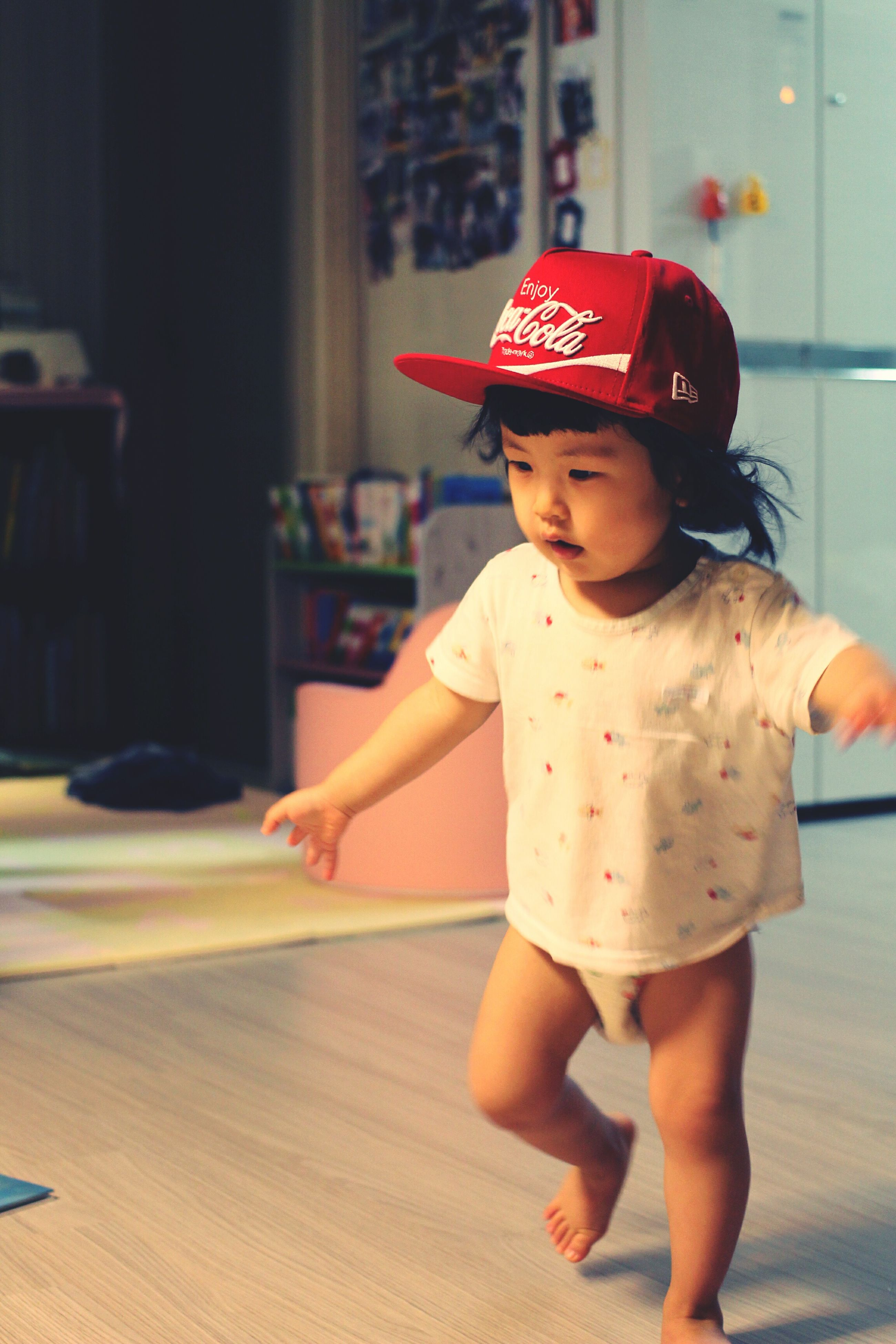 childhood, leisure activity, person, lifestyles, indoors, elementary age, standing, casual clothing, looking down, red, focus on foreground, innocence