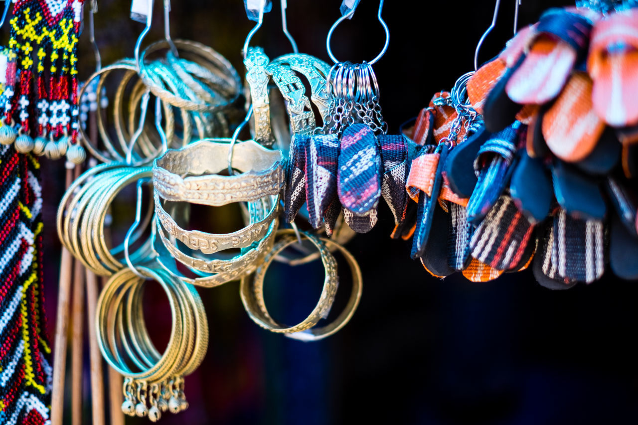 Handmade miniature shoe and slipper key chains and brass bracelets Abaca Accessories Black Background Bracelet Brass Choice Close-up Day Display Fashion Filipino Gold Handmade Hanging Jewelry Key Chain Market Street Miniature Native Product No People Outdoors Retail  Shoes Slipper  T'nalak
