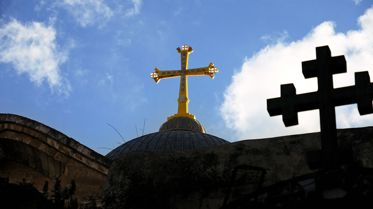 Architecture Built Structure Cloud - Sky Cross Crucifix Day Holy Land Holy Sephulchre Holy Sepulchre Jerusalem Jerusalem Israel Low Angle View No People Outdoors Place Of Worship Religion Sepulcher Sepulchre Sky Spirituality