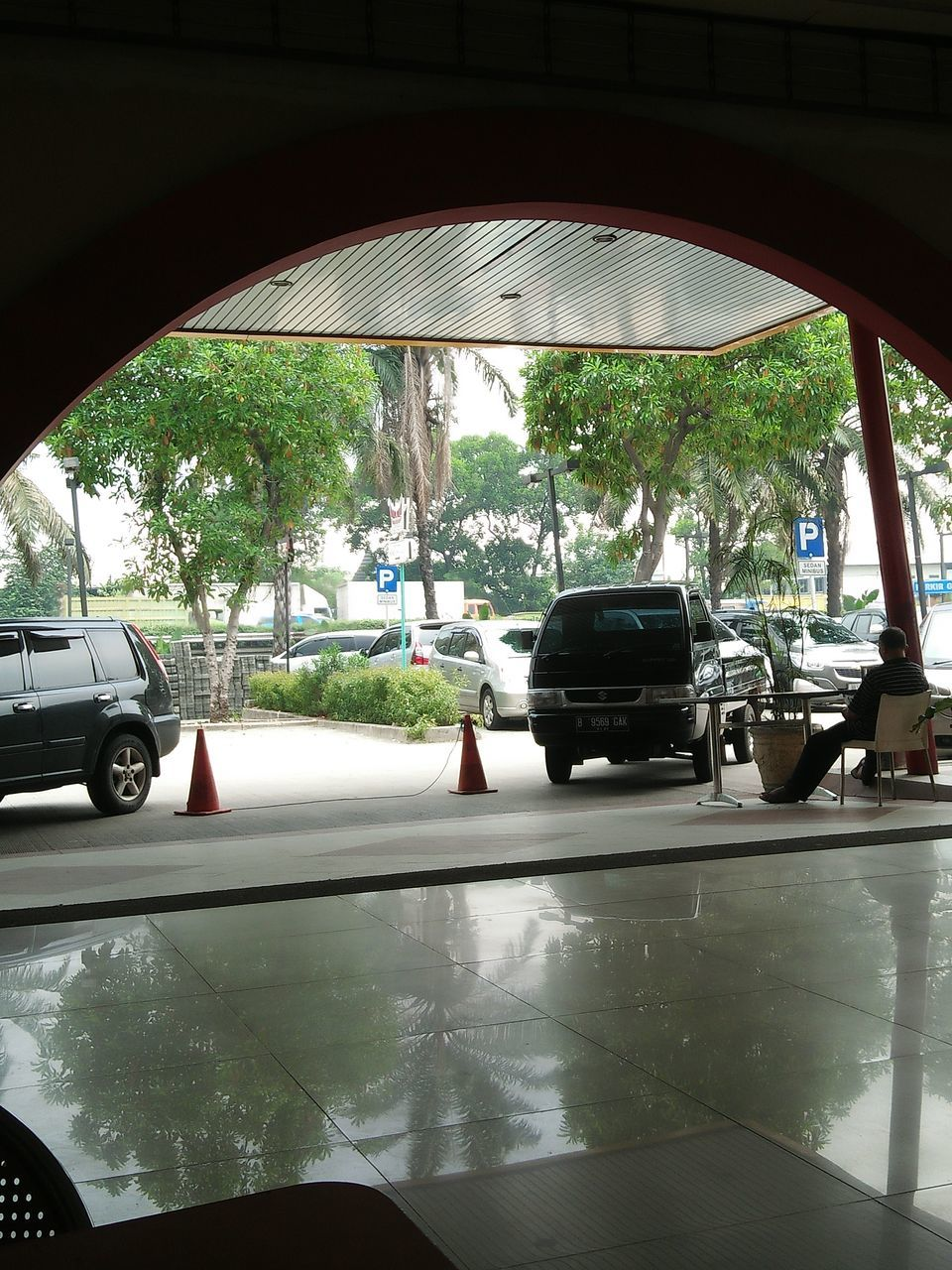 car, transportation, land vehicle, mode of transport, car interior, day, wet, windshield, window, travel, car point of view, stationary, tree, road, road trip, water, no people, indoors, car wash, under