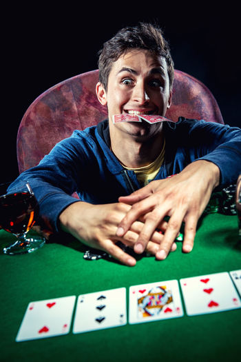 Poker player. Gambling concept Blackjack Casino Gambling Jackpot Man Objects Poker Addiction Bet Casino Night Chance Entertainment Fortune Gambler Gambling Chip Game Male One Person Player Playing Card Games Poker - Card Game Poker Chips Poker Game Studio Shot Young Adult