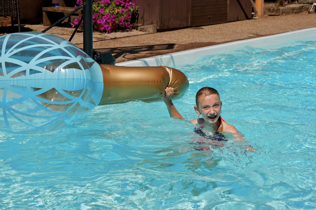 Selected For Premium Selected For Premium. Blond Hair Blonde Girl Wet Hair Swimming Pool Swimming Child Childhood Elementary Age Girl Summertime Swimsuit Day Looking At Camera Hair In Face Inflatable  Pool Toys Funny Laughing Laughter Young Girl Pool Pool Time Outdoors