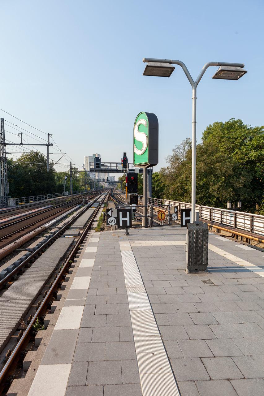 Street Light At Railroad Station Platform Against Sky On Sunny Day