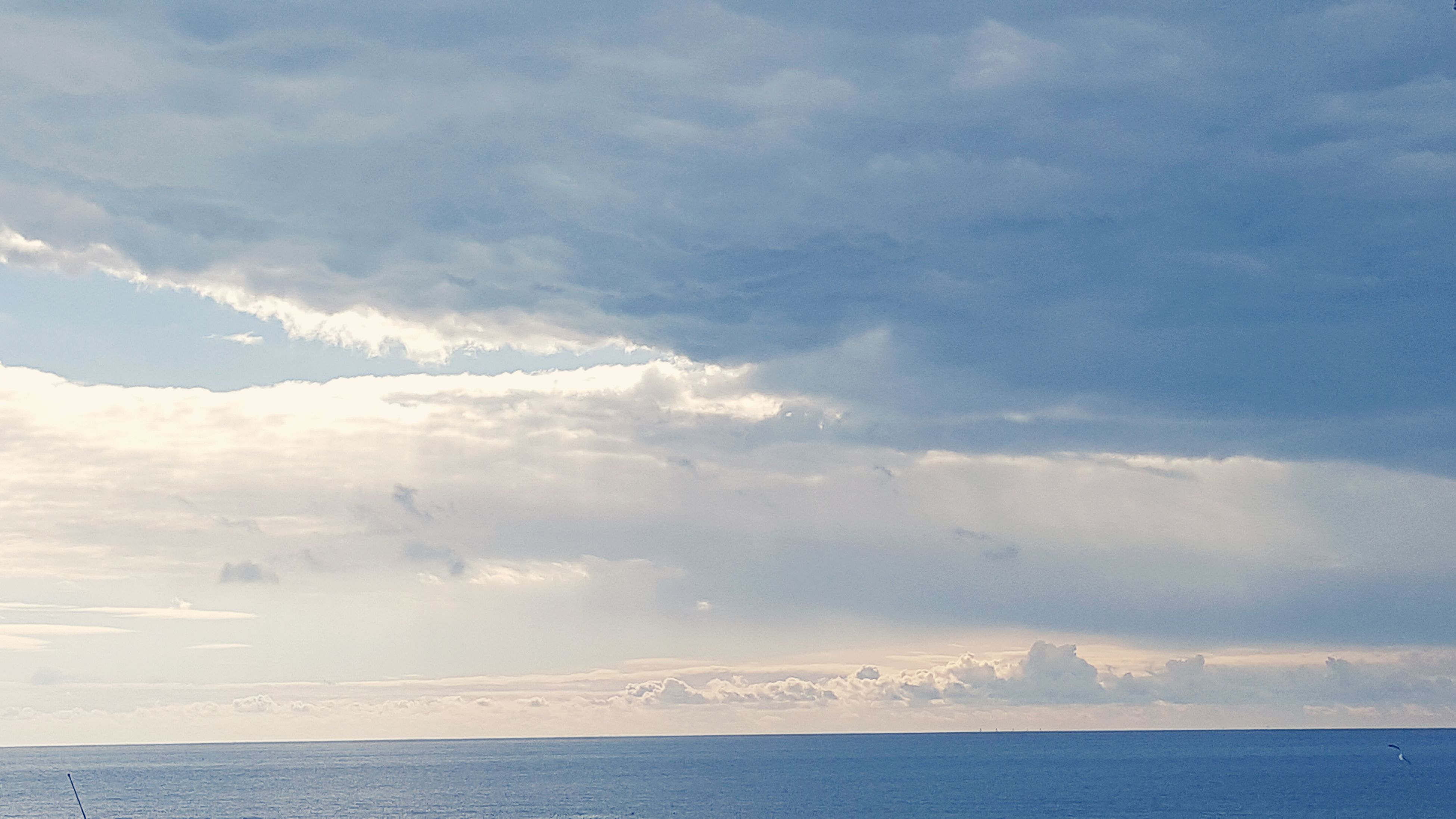 sea, sky, scenics, tranquil scene, water, beauty in nature, tranquility, waterfront, cloud - sky, horizon over water, nature, cloudy, cloud, idyllic, blue, weather, seascape, outdoors, day, no people