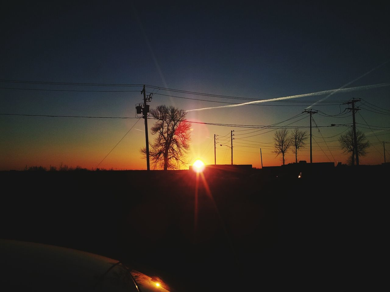 sunset, sun, cable, silhouette, power line, sky, nature, no people, car, electricity, sunlight, electricity pylon, landscape, beauty in nature, technology, outdoors, scenics, tree, day, vapor trail