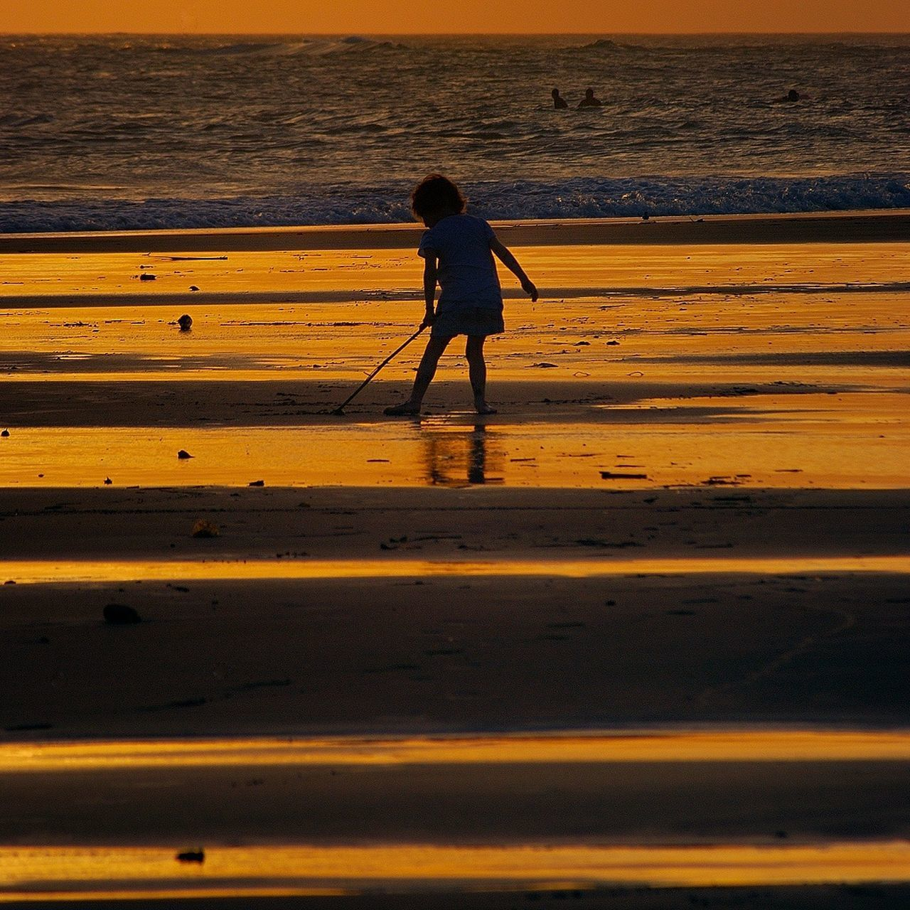 Silhouette Girl Playing At Beach During Sunset