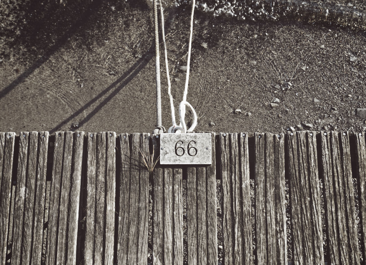 text, hanging, communication, day, outdoors, wood - material, chain, no people, close-up