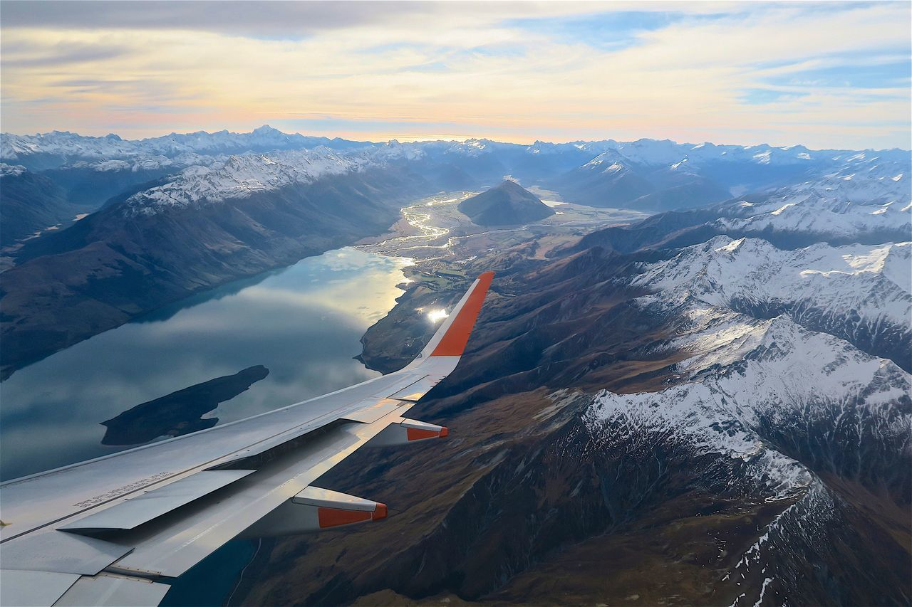 airplane, transportation, cloud - sky, sky, nature, scenics, aerial view, airplane wing, beauty in nature, journey, flying, no people, travel, mode of transport, mountain, cold temperature, snow, tranquility, tranquil scene, air vehicle, outdoors, winter, landscape, aircraft wing, mountain range, day, snowcapped mountain