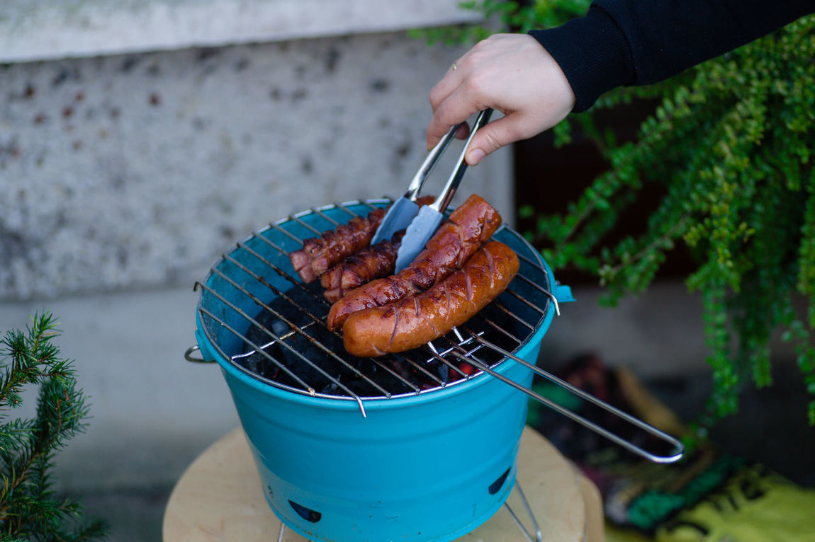 Cooking and turning sausages on a barbecue with a clamp Barbecue BBQ Beef Burger Burned Cooked Cooked Breakfast, Food Food And Drink Grill Grilled Meat Grilling Food Hot Food Smoke Meat Outdoor Camping Outdoor Eating Outdoors Portable Bbq Preparation  Roast Smokey Tasteful Tasty Food Yummy Food