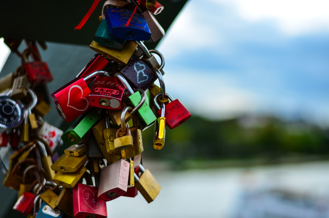 Close-up Day Focus On Foreground Hope - Concept Large Group Of Objects Lock Love Lock Multi Colored No People Outdoors Padlock Protection Railing Safety Security Sky Travel Variation