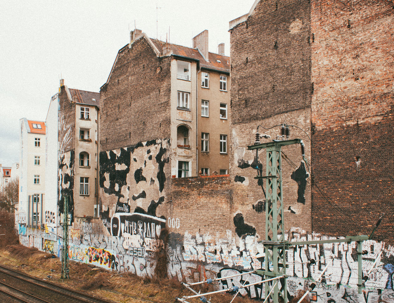 Ghetto Prenzlauer Berg. Architecture Balcony Berlin Berlin Photography Berliner Ansichten Building Exterior Built Structure City Clear Sky Day Façade Glass Graffiti House No People Outdoors Prenzlauerberg Railroad Track Sky Streetart Streetphotography Urban Window Windows