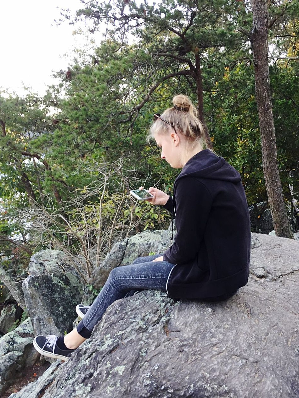 Mobile Conversations Full Length Young Adult Wireless Technology Sitting Side View One Young Woman Only Blond Hair One Woman Only Tree One Person Only Women Young Women Connection Technology Adults Only Day Outdoors People Nature Adult