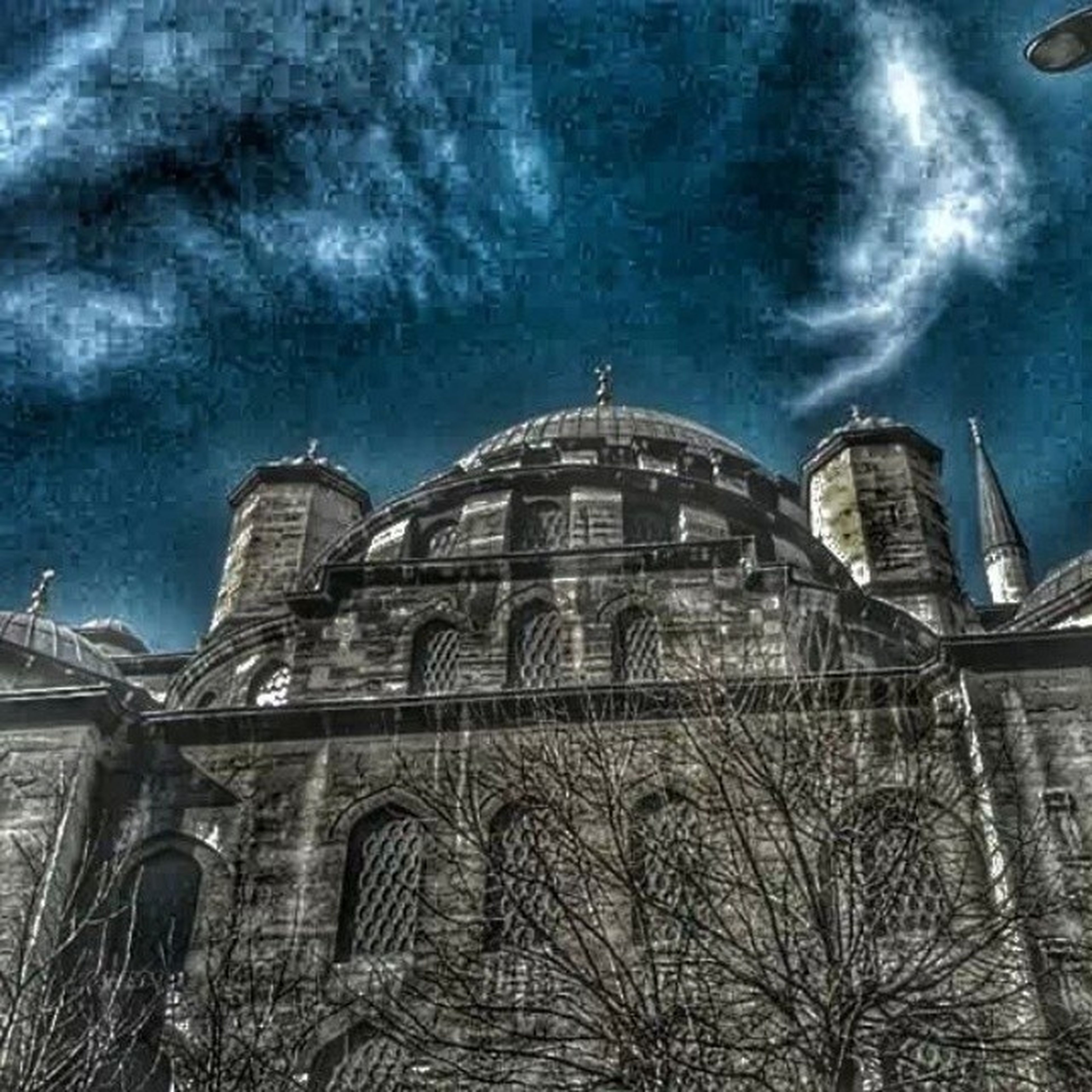 architecture, built structure, building exterior, sky, low angle view, cloud - sky, cloudy, church, arch, cloud, religion, place of worship, building, history, window, day, no people, old, outdoors