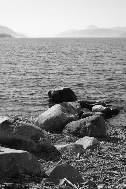 Dores Atmospheric Mood Black And White Hills In The Distance Loch Ness Mist Shingle Beach Shoreline Water Waves And Rocks