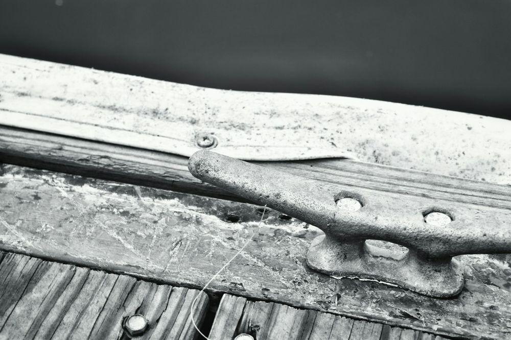 Up Close Wood Wood Grain Pier Tie Boat Tie Rope Tie Metal Bolt