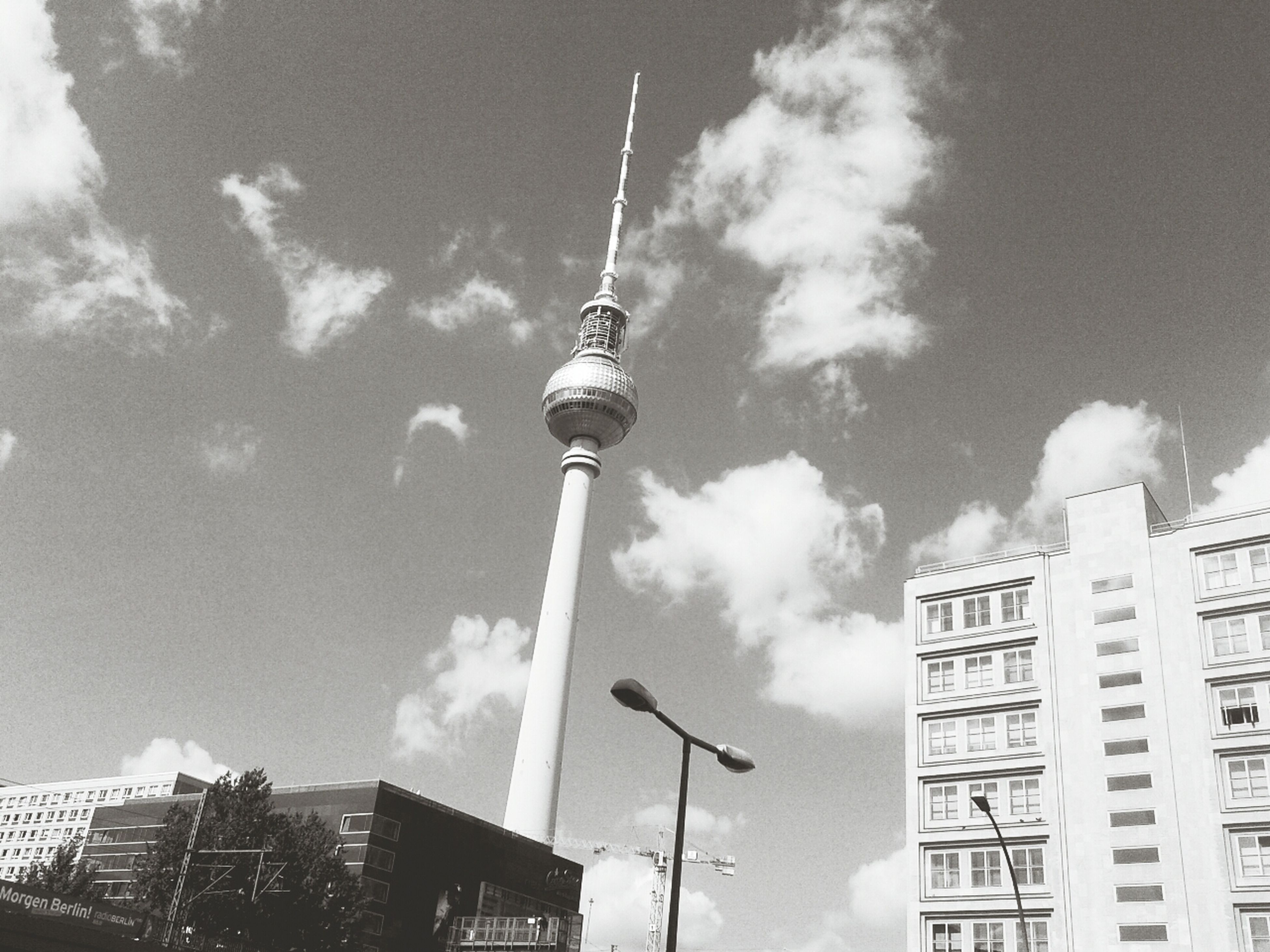 building exterior, architecture, built structure, low angle view, tall - high, tower, city, communications tower, sky, spire, skyscraper, fernsehturm, television tower, communication, cloud - sky, capital cities, culture, travel destinations, modern, office building