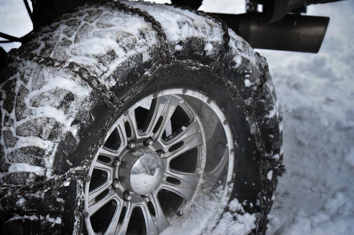 Transportation Wheel Mode Of Transport Tire No People Close-up Outdoors Day Chains Tire Chains Traction Snow ❄ Truck Tires Winter Cold Snow Cold Temperature Safety Metal Chains Metal Better Safe Than Sorry Frozen Snow Covered Driveway