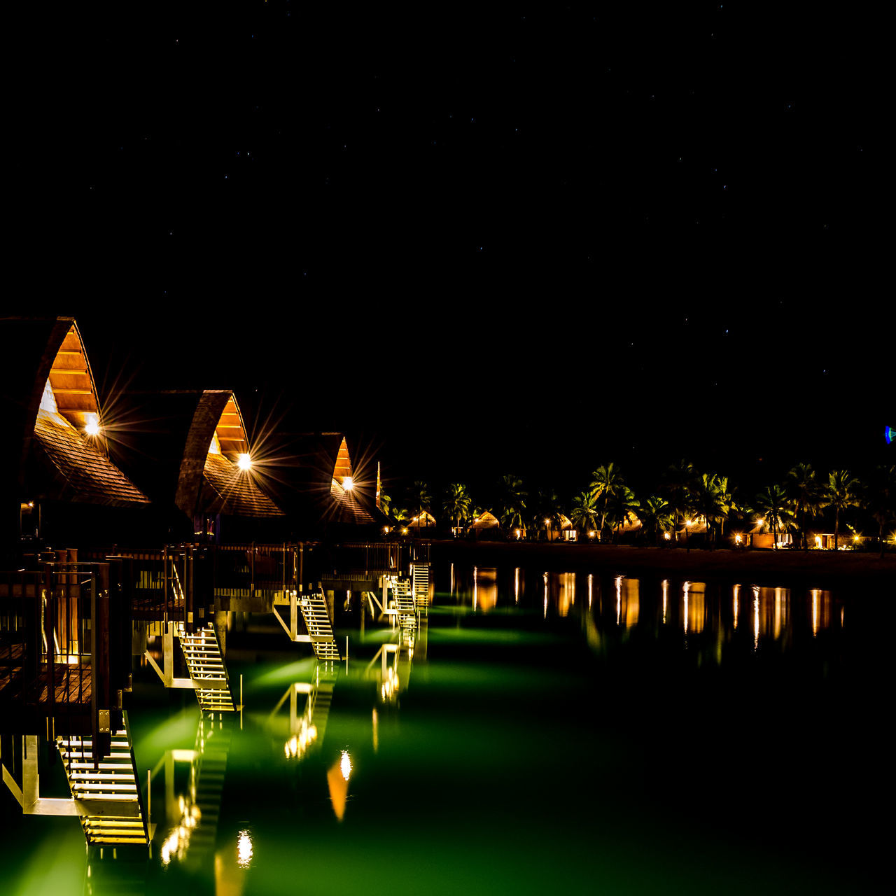 Lagoon at night Architecture Building Exterior Built Structure Bure Clear Sky Fiji Illuminated Lagoon Lagoon Water Night No People Outdoors Sky Water Waterfront The Great Outdoors - 2017 EyeEm Awards