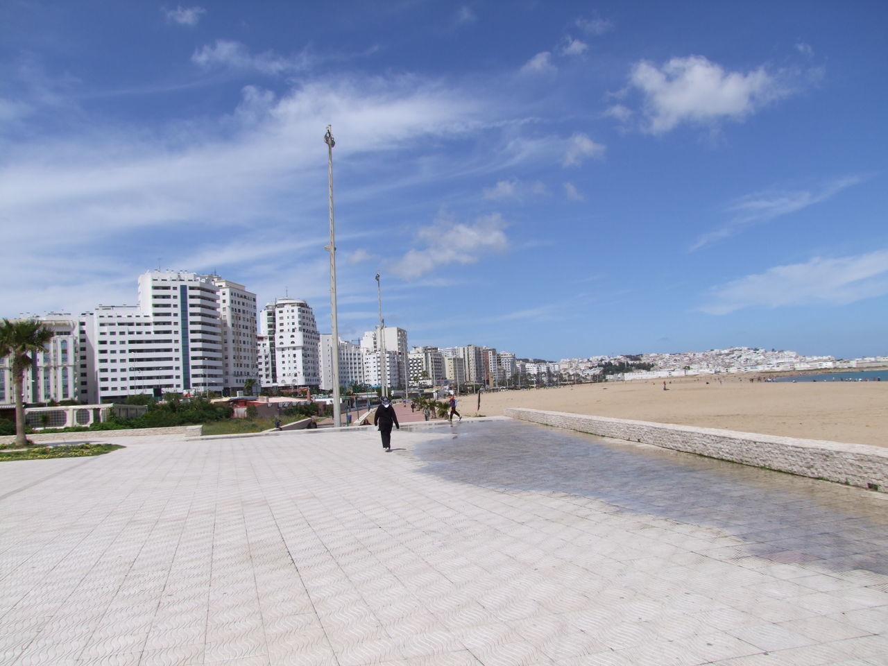 Tangier City Promenade Architecture Beach Blue Sky White Clouds City Composition Distant View Famous Place Modern Architecture Morocco No People Outdoor Photography Promenade Sand Sea Sunlight Tangier Tangier City Tourism Destination Tourist Attraction  Tourist Destination Travel Destinations Urban Skyline