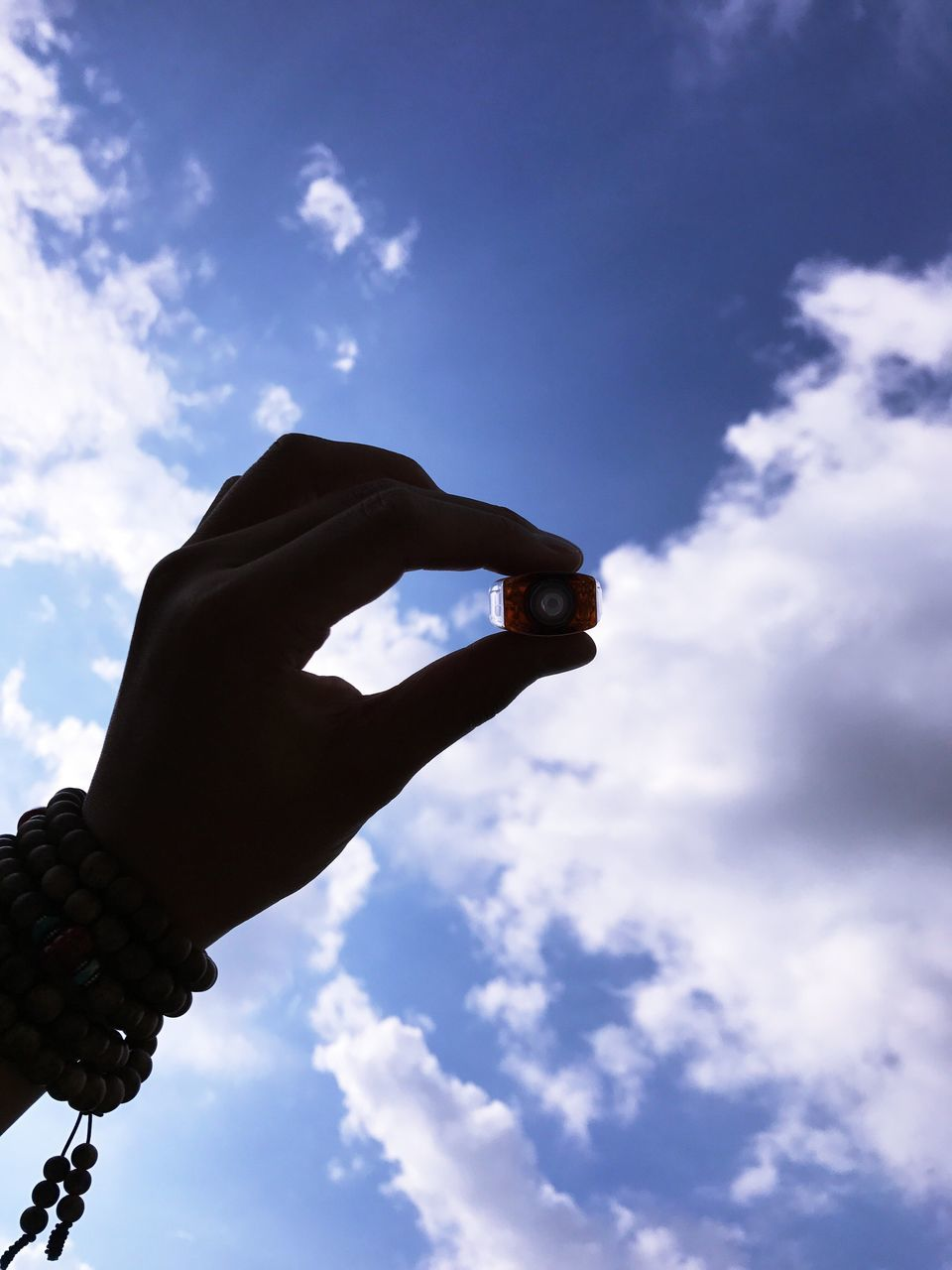 sky, human hand, cloud - sky, low angle view, human body part, one person, real people, outdoors, day, blue, men, nature, close-up, people