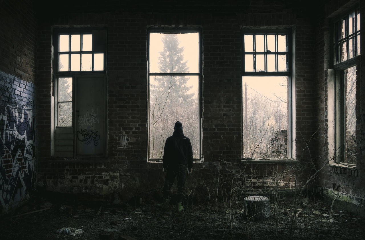 One man standing in abandoned industrial building. Abandoned Buildings Broken Broken Glass Built Structure Dark Darkness And Light Day Decay Depressed Gloomy Weather Graffiti Art Indoors  Industrial Lifestyles Man Men Messy One Person People Real People Standing Window Windows