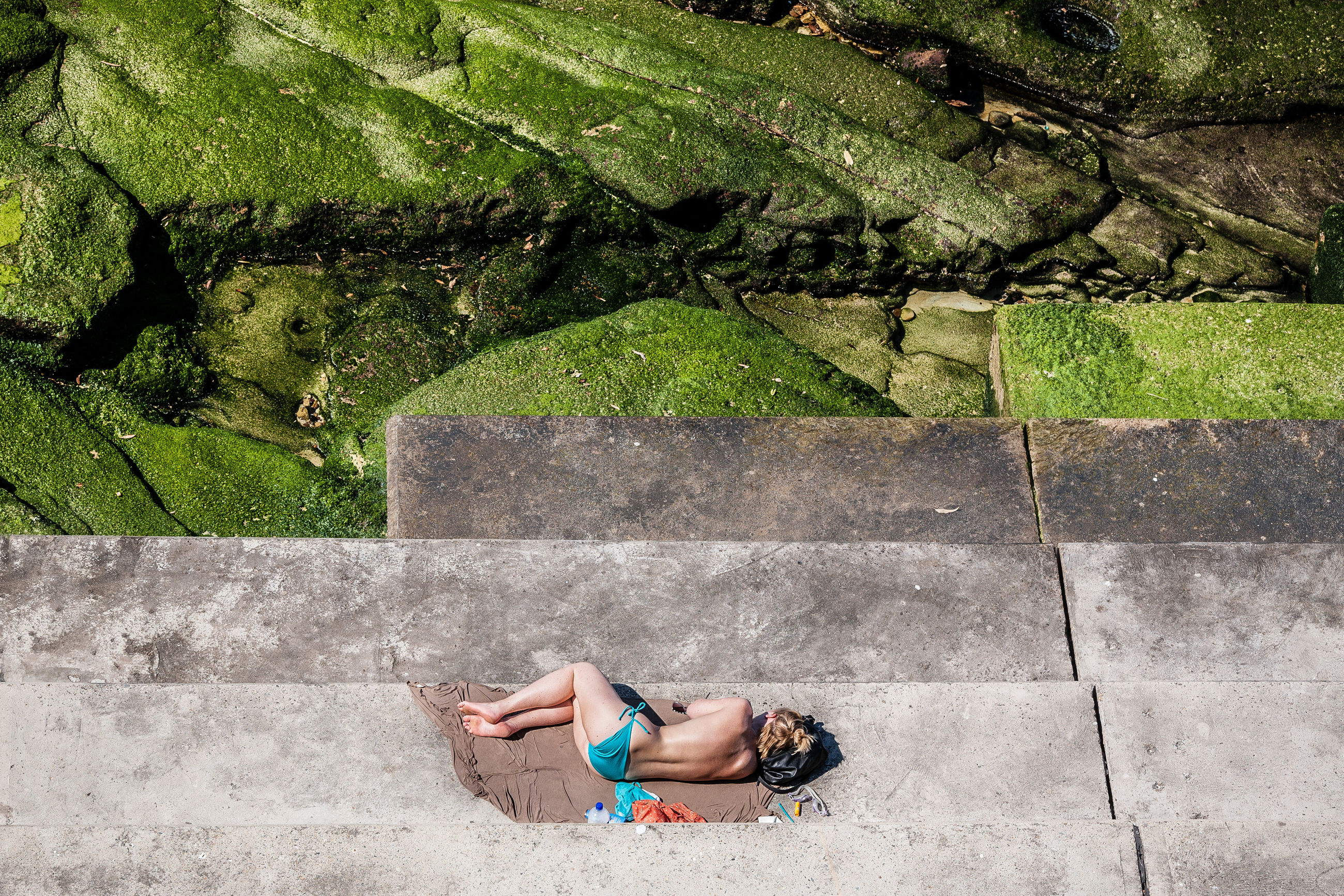 high angle view, outdoors, day, one person, young adult, leisure activity, lying down, young women, lifestyles, full length, one young woman only, one woman only, water, women, real people, only women, adults only, adult, people