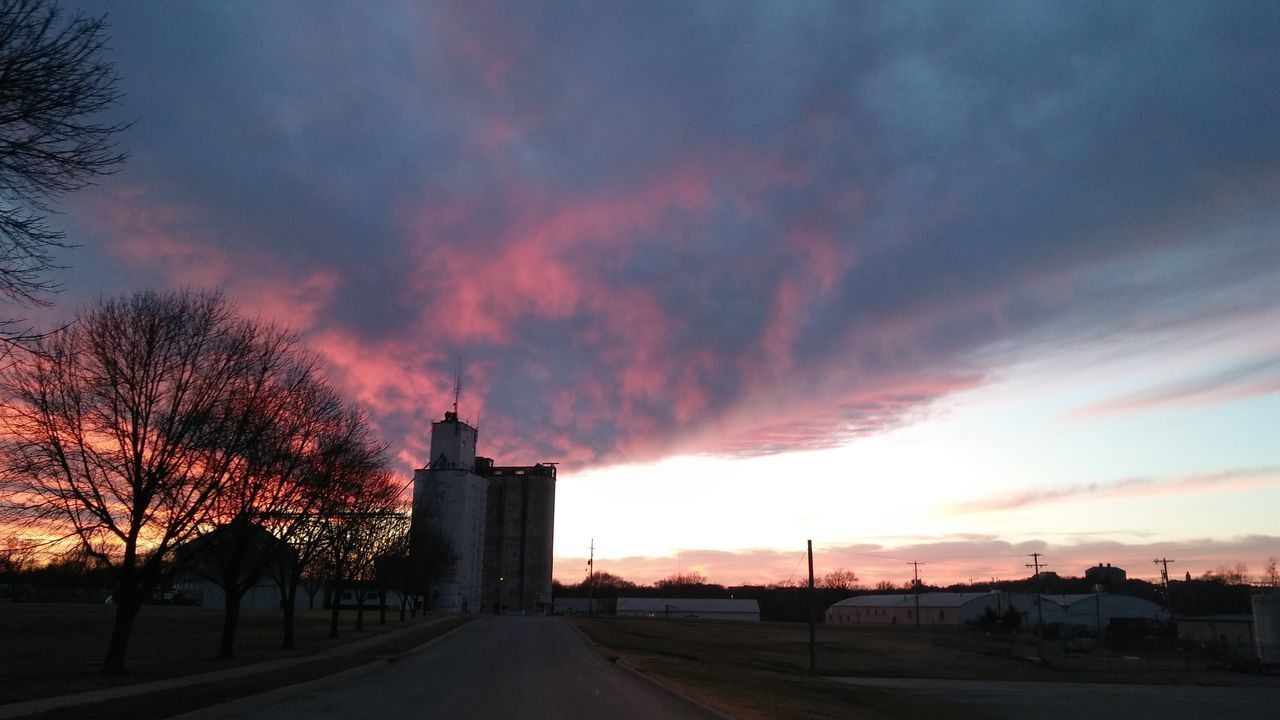 Dramatic Sky Sunset Cloud - Sky Outdoors No People Architecture Grain Silo Clouds And Sky Colors