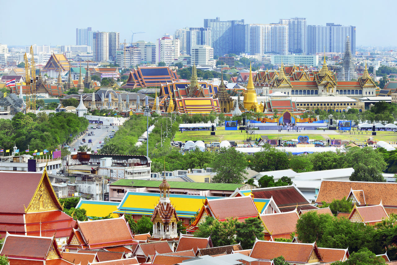 Grand palace and Wat phra keaw at evening bangkok, Thailand Aerial View Architecture Building Exterior City Cityscape Crowded Day Downtown District Grand Palace Bangkok Thailand High Angle View Housing Development Outdoors Residential Building Roof Skyscraper Social Issues Tree Urban Skyline Wat Phra Keaw