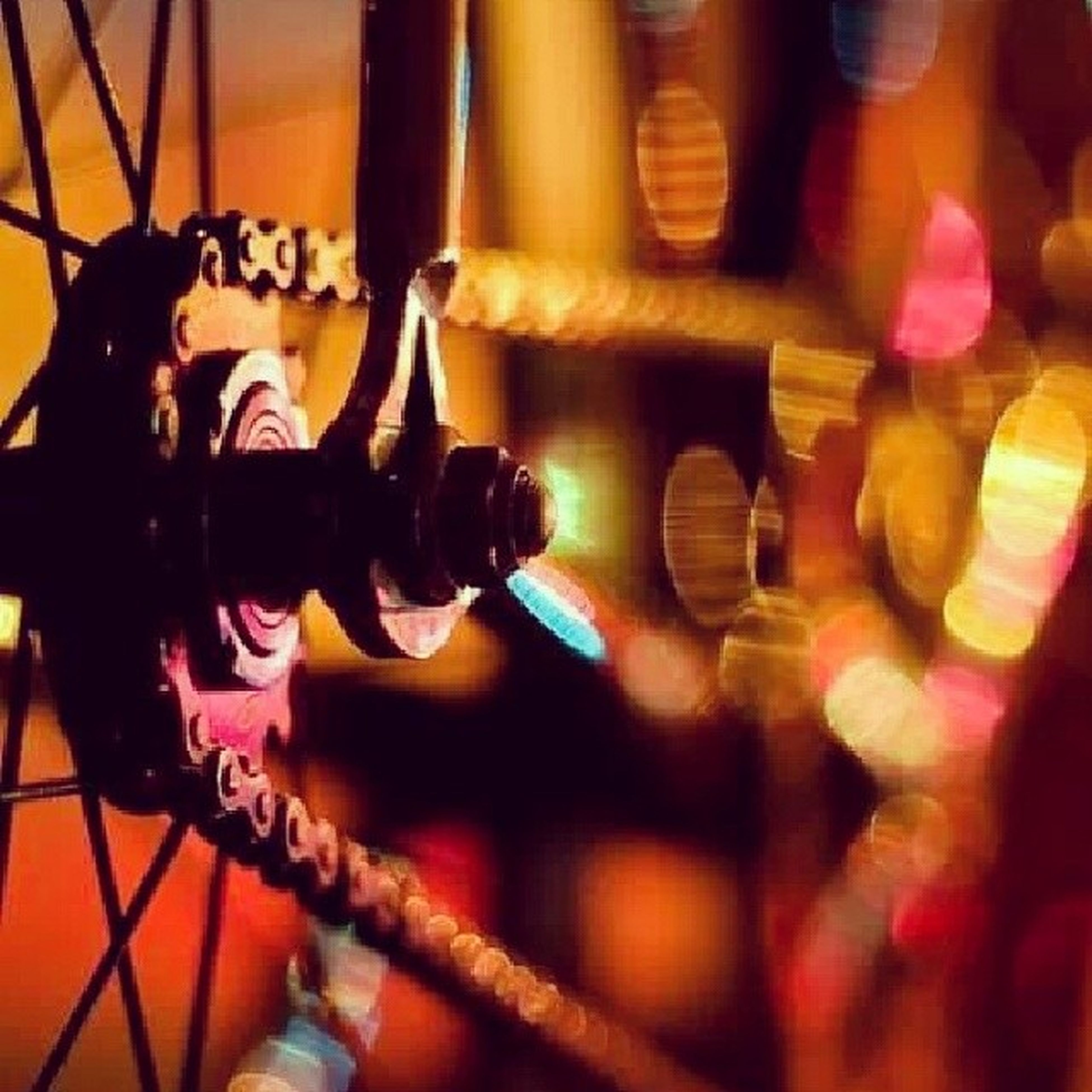 indoors, lifestyles, illuminated, leisure activity, men, blurred motion, person, selective focus, standing, lighting equipment, technology, arts culture and entertainment, transportation, multi colored, wall - building feature, reflection, defocused