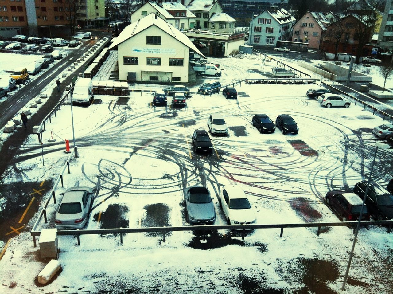 cold temperature, winter, snow, season, architecture, building exterior, built structure, transportation, mode of transport, high angle view, weather, house, covering, city, travel, car, residential building, residential structure, land vehicle, city life, travel destinations, nature, tourism, day, outdoors, no people, scenics, residential district, beauty in nature