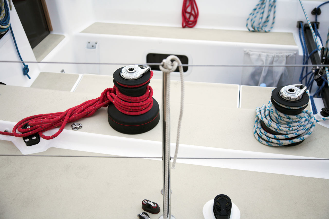 Sailing boat equipment and details Blue White And Red Boat Boat Deck Close-up Day Deck Details Equipment Holidays Leisure Leisure Activity Lines No People On Board Red Rope Ropes Sail Sailboat Sailing Sailing Boat Sailor Vacation Time Vacations White