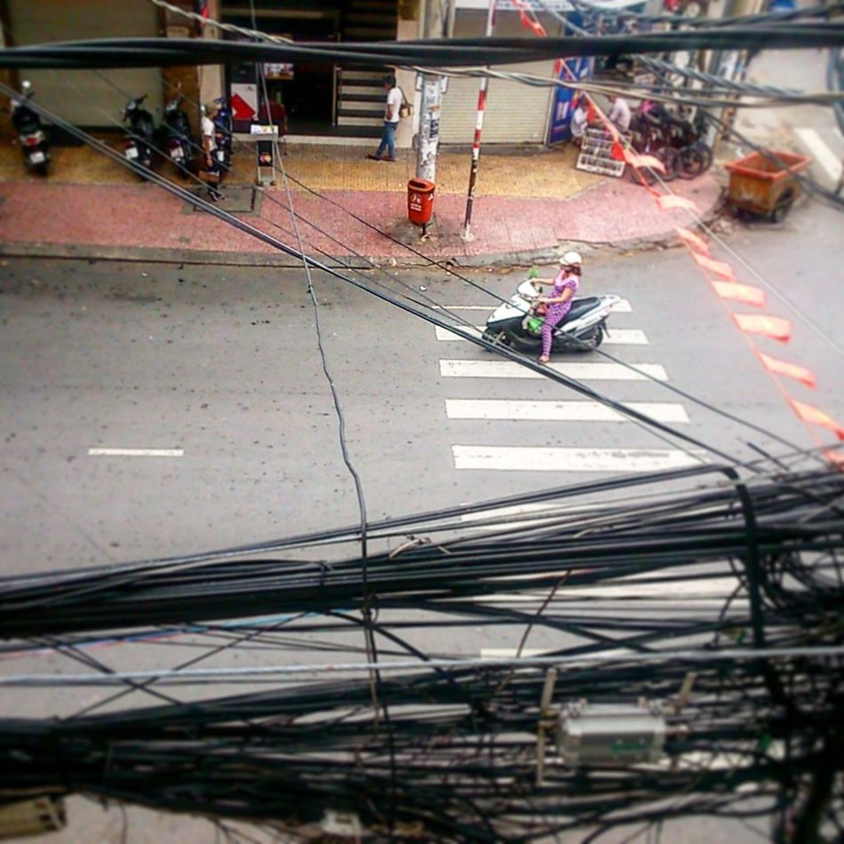 Vietnam Working Holliday Smartphonephotography Streetphotography Electricity  Scooter Woman Powercabels Roofterrace