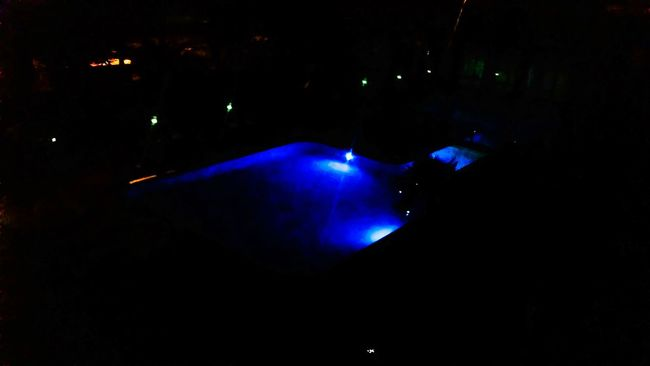 Illuminated Glowing Night Dark Blue Nightlife Vibrant Color Scenics Vacations Electric Light Ethereal Atmosphere Multi Colored Back Lit Poolview Darkness Tranquil Scene Light Beam Tranquility Tourism Majestic Vivid Colours  No People Freshness Water