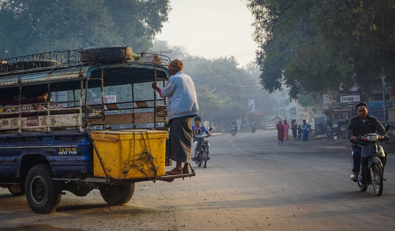 real people, transportation, mode of transport, land vehicle, outdoors, tree, men, day, road, occupation, one person, architecture, working, people