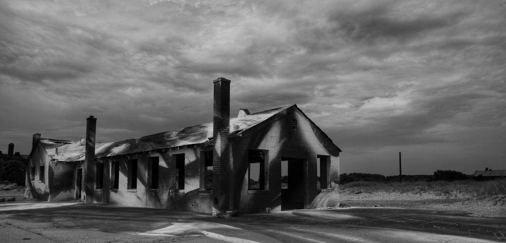 This was originally in color but it matters not anymore, it's been demolished. Here's a version of it free of color. Life Guard Station Photography Clouds And Sky Black And White Outdoors Beach Sand Cloud - Sky No People Sky Architecture Day