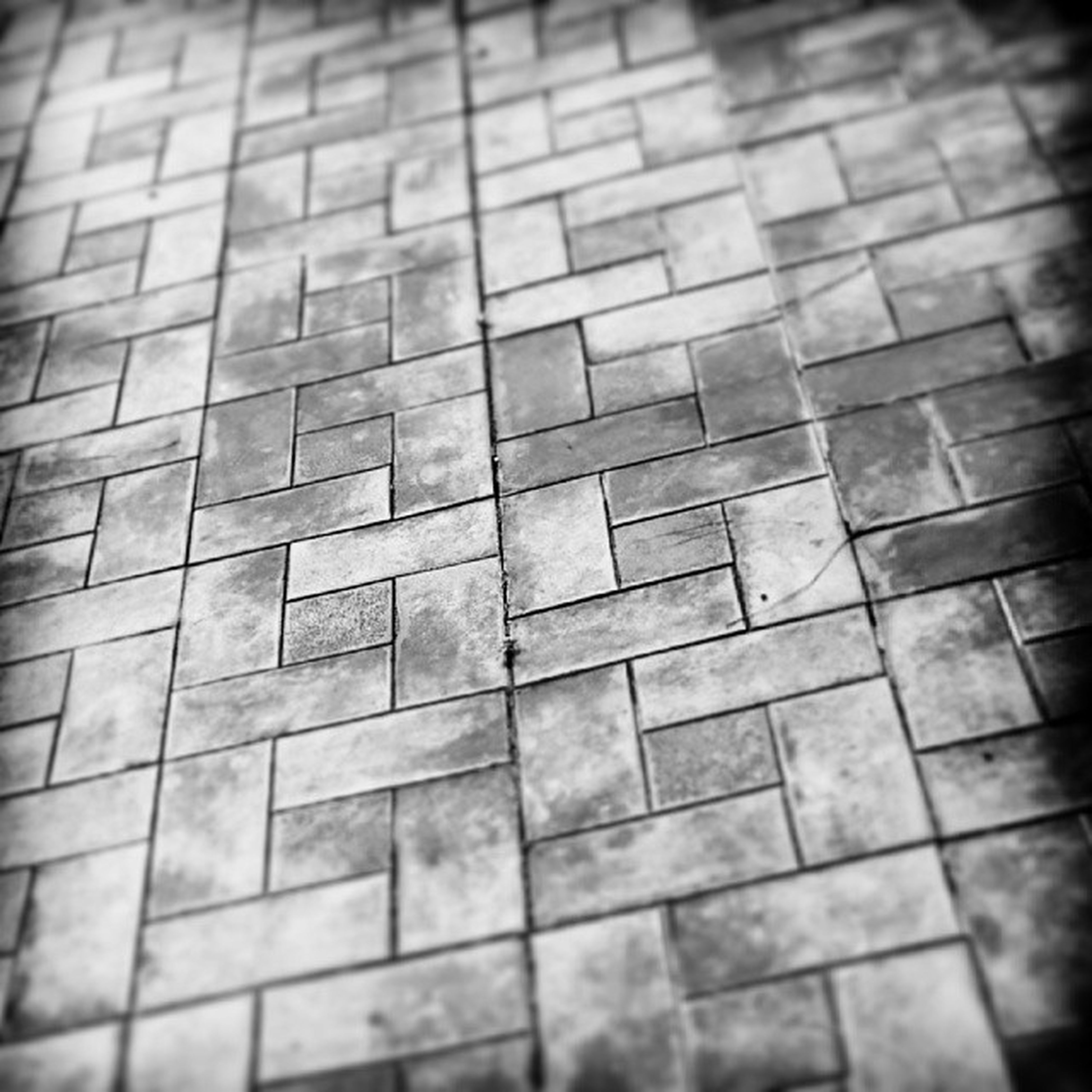 full frame, backgrounds, pattern, indoors, textured, square shape, close-up, tiled floor, geometric shape, flooring, wall - building feature, no people, tile, selective focus, high angle view, day, design, repetition, built structure, shape