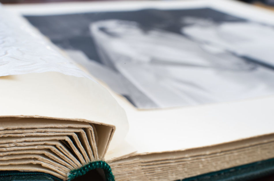 Old vintage wedding photo album with out of focus black and white image Analog Photography Book Close-up Marriage  Old Paper Photo Album Photo Book Photography Selective Focus The Past Vintage Wedding Photography